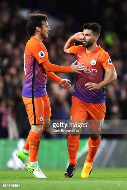 Sergio Aguero of Manchester City celebrates scoring his team's first goal to make the score 11 with David Silva during the Premier League match...