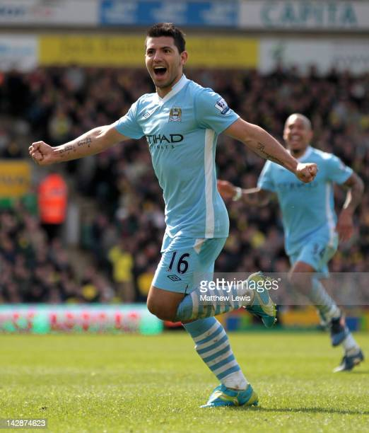 Sergio Aguero of Manchester City celebrates scoring his team's fourth goal during the Barclays Premier League match between Norwich City and...