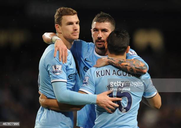 Sergio Aguero of Manchester City celebrates scoring his team's fourth goal with teammates Edin Dzeko and Aleksandar Kolarov during the Budweiser FA...