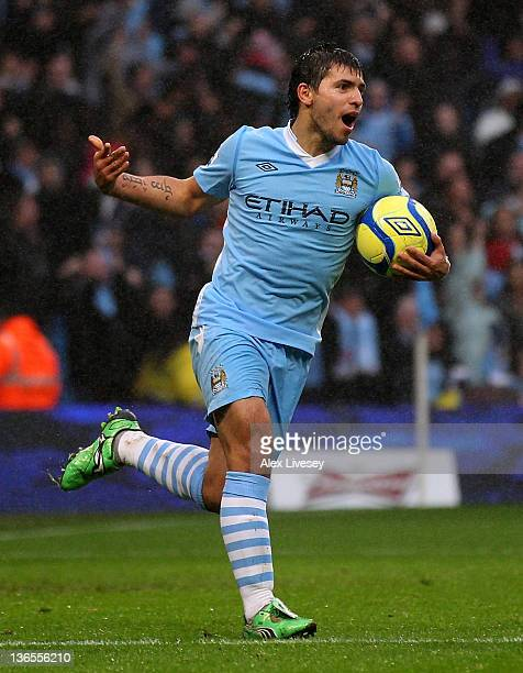 Sergio Aguero of Manchester City celebrates scoring his team's second goal during the FA Cup Third Round match between Manchester City and Manchester...