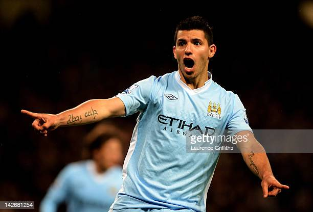 Sergio Aguero of Manchester City celebrates scoring his team's second goal during the Barclays Premier League match between Manchester City and West...