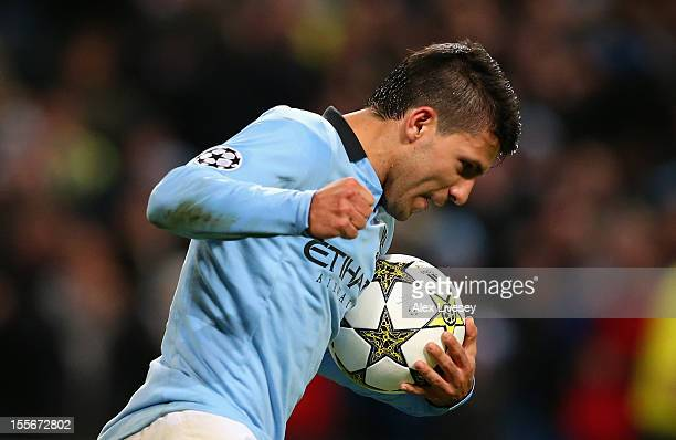 Sergio Aguero of Manchester City celebrates scoring his team's second goal during the UEFA Champions League Group D match between Manchester City FC...