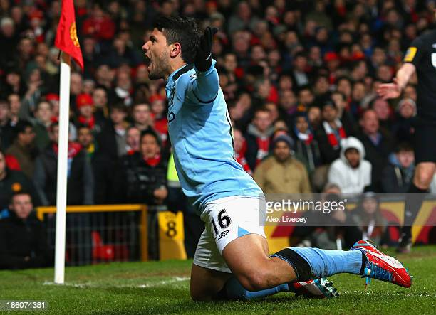 Sergio Aguero of Manchester City celebrates scoring his team's second goal to make the score 12 during the Barclays Premier League match between...