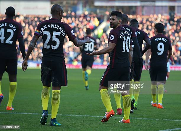 Sergio Aguero of Manchester City celebrates scoring his team's second goal with his team mate Fernandinho during the Premier League match between...