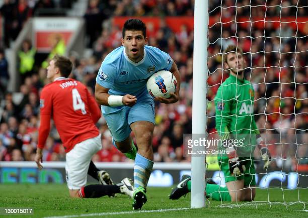 Sergio Aguero of Manchester City celebrates scoring his team's third goal during the Barclays Premier League match between Manchester United and...