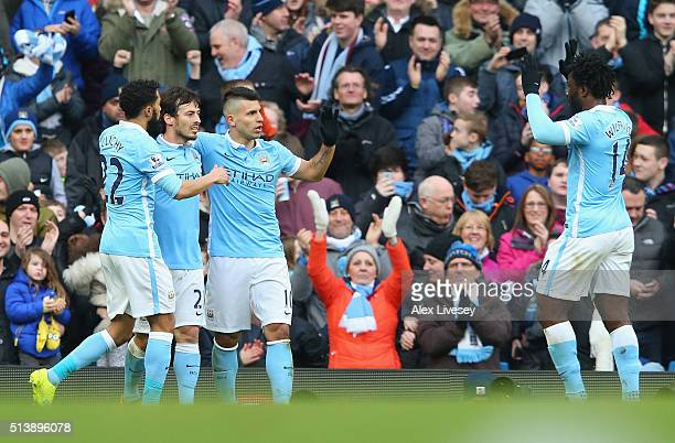 Sergio Aguero of Manchester City celebrates scoring his team's third goal with his team mates during the Barclays Premier League match between...