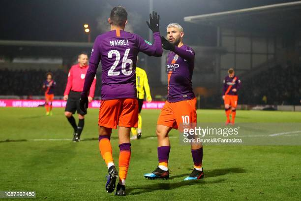 Sergio Aguero of Manchester City celebrates scoring the opening goal with teammate Riyad Mahrez during the Carabao Cup Semi Final Second Leg match...