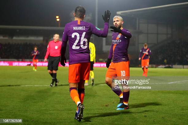 Sergio Aguero of Manchester City celebrates scoring the opening goal with team-mate Riyad Mahrez during the Carabao Cup Semi Final Second Leg match...