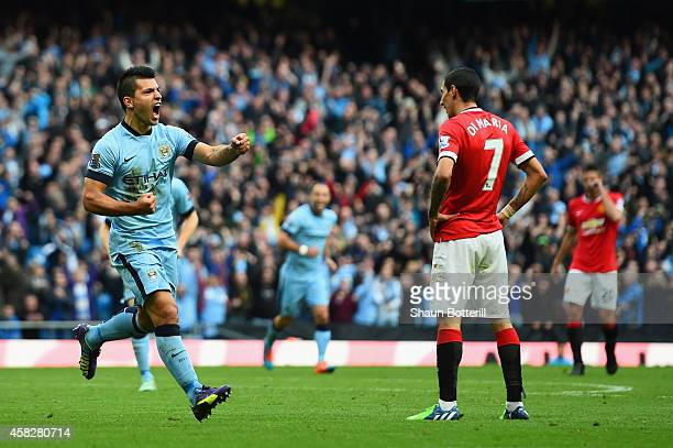 Sergio Aguero of Manchester City celebrates scoring the opening goal during the Barclays Premier League match between Manchester City and Manchester...