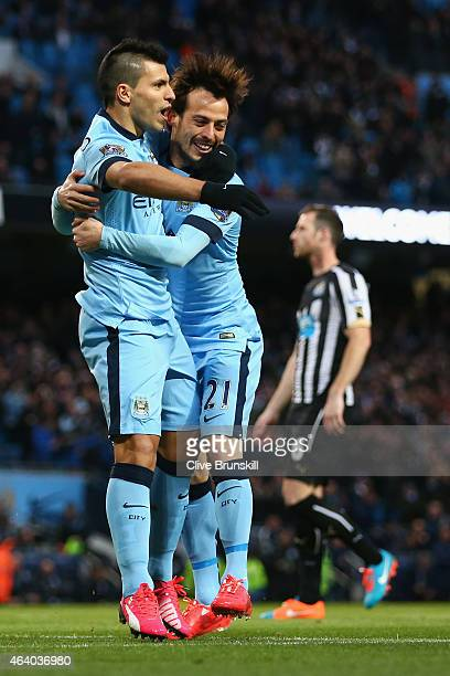 Sergio Aguero of Manchester City celebrates scoring the opening goal from the penalty spot with David Silva of Manchester City during the Barclays...