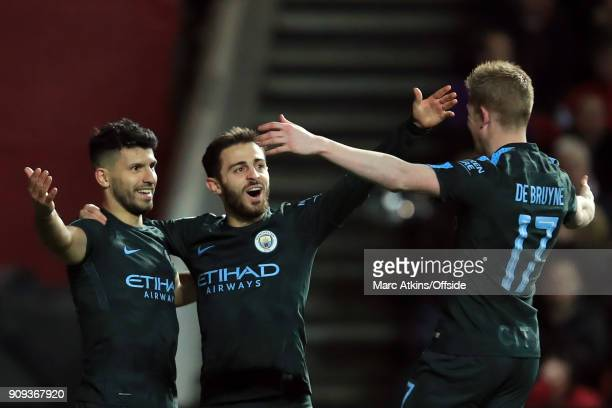 Sergio Aguero of Manchester City celebrates scoring their 2nd goal with Kevin De Bruyne and Bernardo Silva during the Carabao Cup SemiFinal 2nd leg...