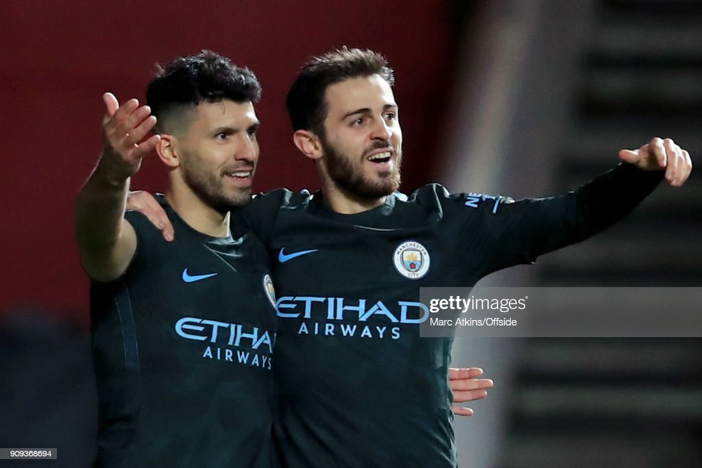 Sergio Aguero of Manchester City celebrates scoring their 2nd goal with Bernardo Silva during the Carabao Cup Semi-Final 2nd leg match between Bristol City and Manchester City at Ashton Gate on January 23, 2018 in Bristol, England.