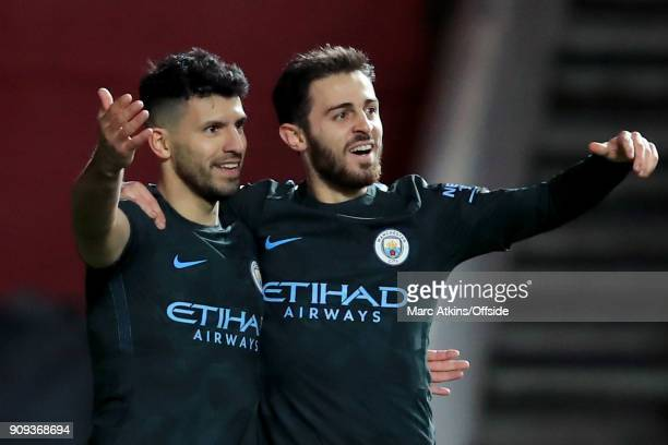 Sergio Aguero of Manchester City celebrates scoring their 2nd goal with Bernardo Silva during the Carabao Cup SemiFinal 2nd leg match between Bristol...