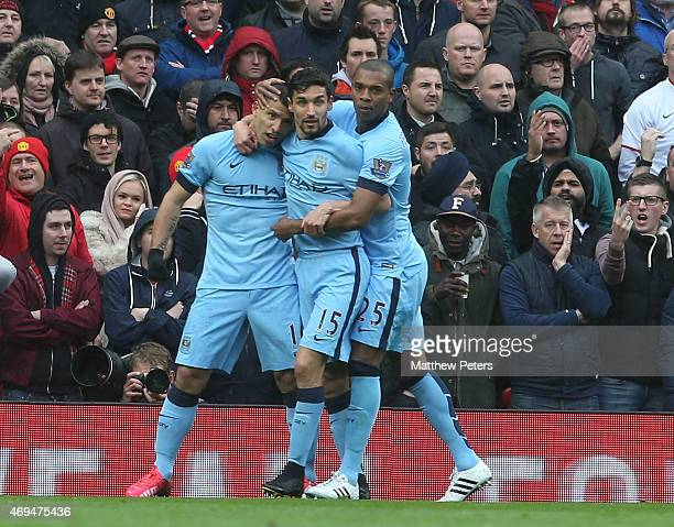 Sergio Aguero of Manchester City celebrates scoring their first goal during the Barclays Premier League match between Manchester United and...