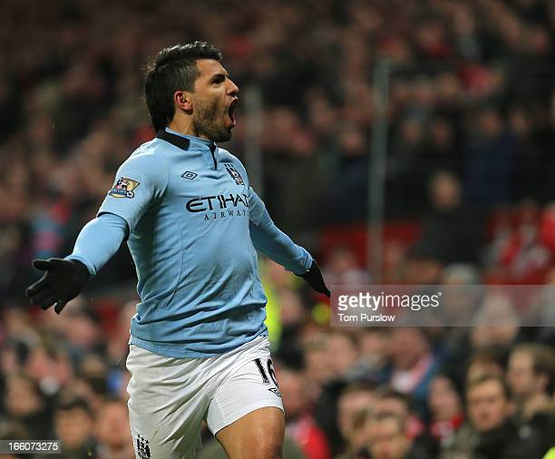 Sergio Aguero of Manchester City celebrates scoring their second goal during the Barclays Premier League match between Manchester United and...