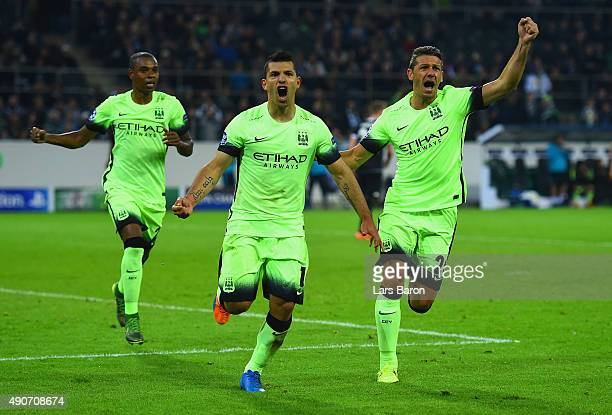 Sergio Aguero of Manchester City celebrates scoring their second goal from the penalty spot during the UEFA Champions League Group D match between...