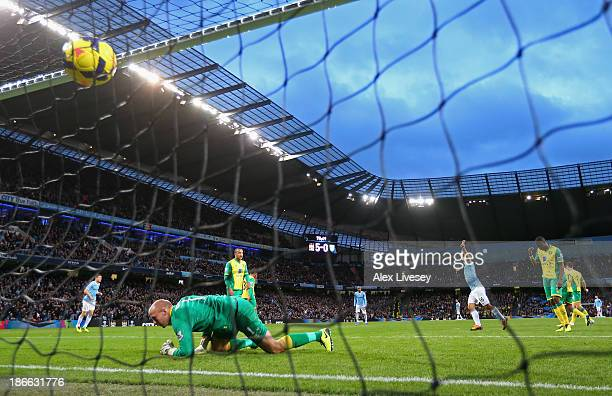 Sergio Aguero of Manchester City celebrates the sixth goal during the Barclays Premier League match between Manchester City and Norwich City at...