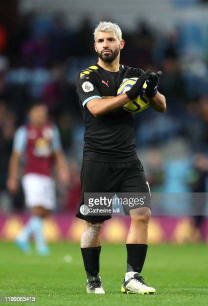 Sergio Aguero of Manchester CIty celebrates victory with the match ball after he scored a hattrick during the Premier League match between Aston...