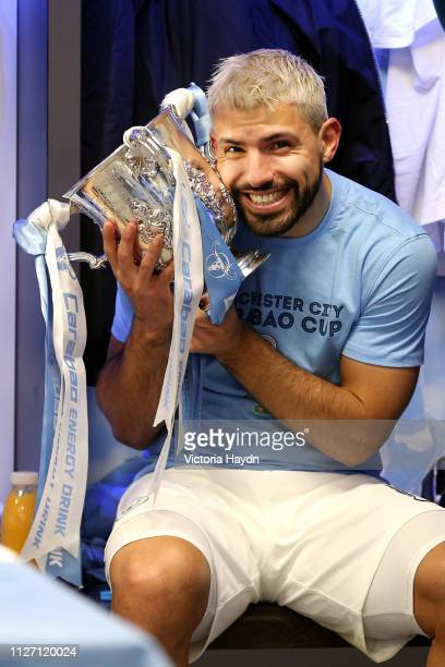 Sergio Aguero of Manchester City celebrates victory with the trophy in the dressign room after the Carabao Cup Final between Chelsea and Manchester...
