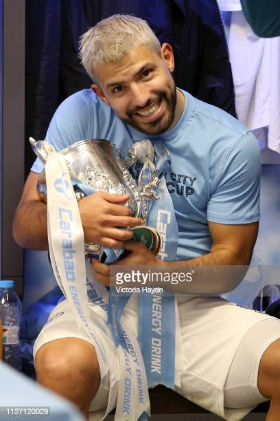 Sergio Aguero of Manchester City celebrates victory with the trophy in the dressing room after the Carabao Cup Final between Chelsea and Manchester...
