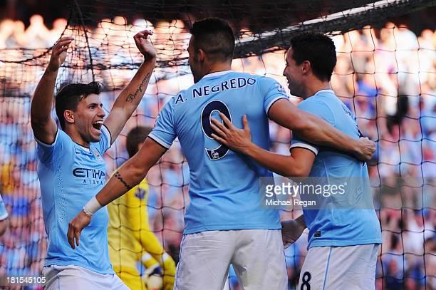 Sergio Aguero of Manchester City celebrates with Alvaro Negredo and Samir Nasri as he scores their third goal during the Barclays Premier League...
