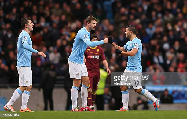 Sergio Aguero of Manchester City celebrates with Edin Dzeko after scoring his first goal during the FA Cup Fourth Round match sponsored by Budweiser...