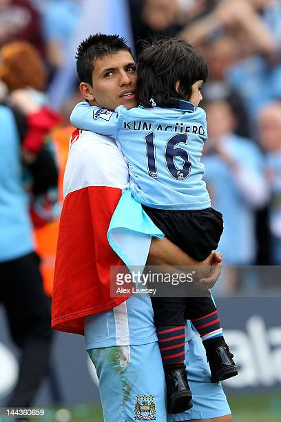 Sergio Aguero of Manchester City celebrates with his daughter following the Barclays Premier League match between Manchester City and Queens Park...