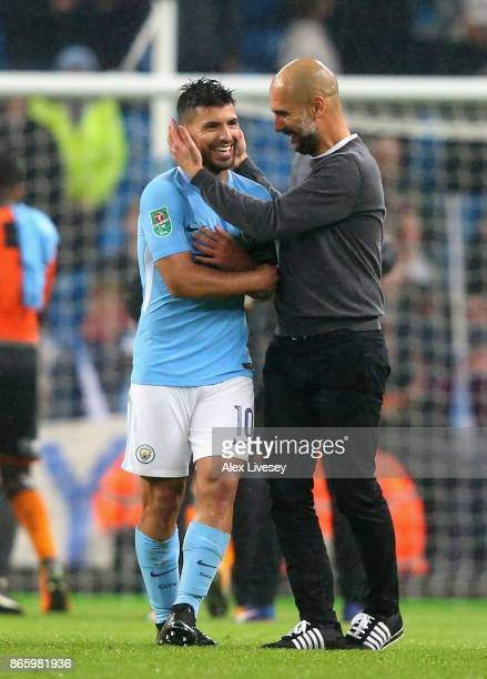 Sergio Aguero of Manchester City celebrates with Josep Guardiola Manager of Manchester City after the Carabao Cup Fourth Round match between...