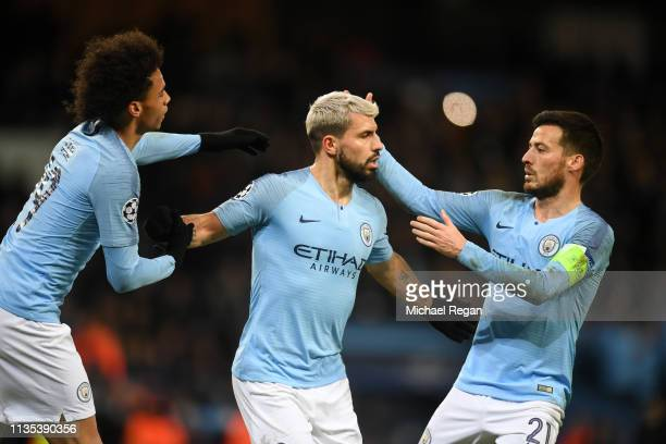 Sergio Aguero of Manchester City celebrates with Leroy Sane of Manchester City and David Silva of Manchester City after scoring his sides first goal...