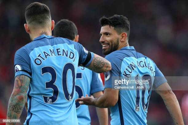 Sergio Aguero of Manchester City celebrates with Nicolas Otamendi of Manchester City during the Premier League match between Southampton and...