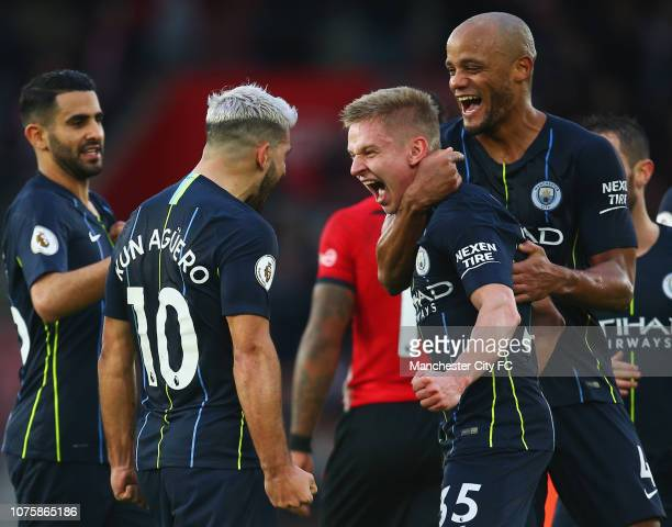 Sergio Aguero of Manchester City celebrates with Oleksandr Zinchenko and Vincent Kompany of Manchester City and team mates as he scores his team's...