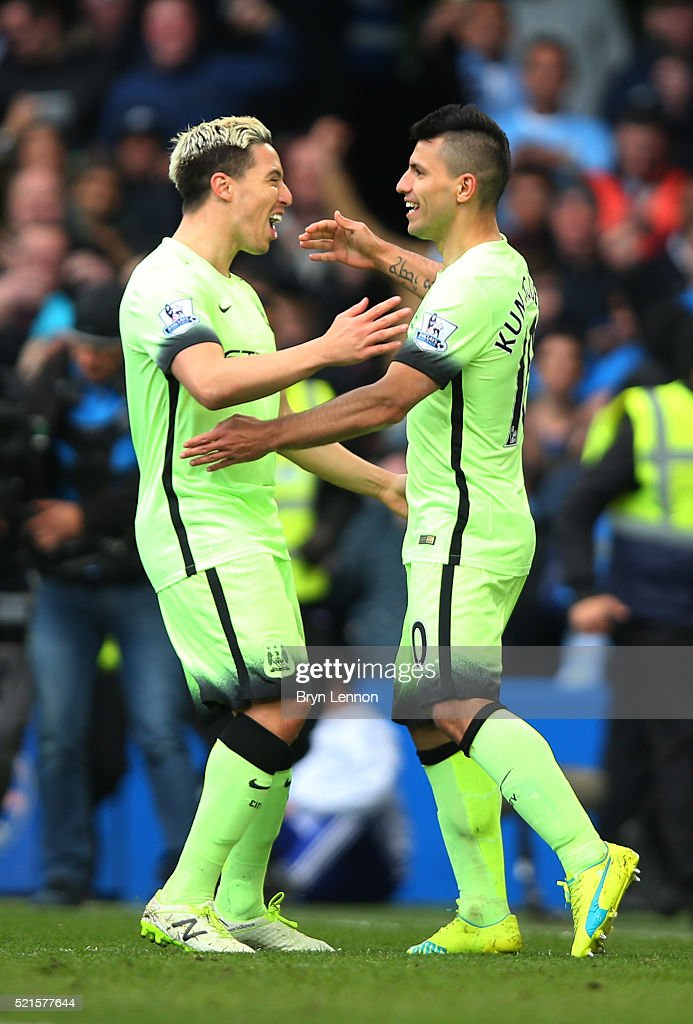 Sergio Aguero of Manchester City celebrates with Samir Nasri after scoring his teams second goal during the Barclays Premier League match between Chelsea and Manchester City at Stamford Bridge on April 16, 2016 in London, England.