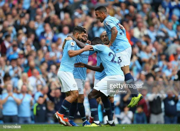 Sergio Aguero of Manchester City celebrates with team mates after scoring his teams first goal during the Premier League match between Manchester...