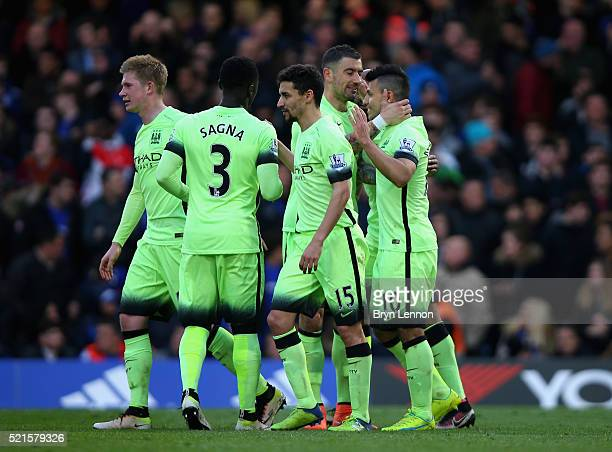 Sergio Aguero of Manchester City celebrates with team mates after scoring his third goal during the Barclays Premier League match between Chelsea and...