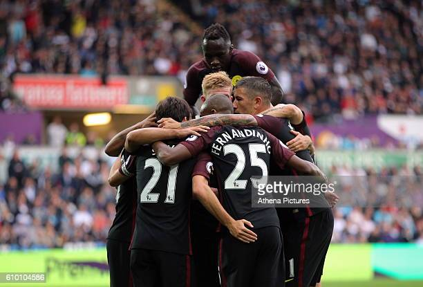 Sergio Aguero of Manchester City celebrates with team mates his goal he scored from the penalty spot during the Premier League match between Swansea...