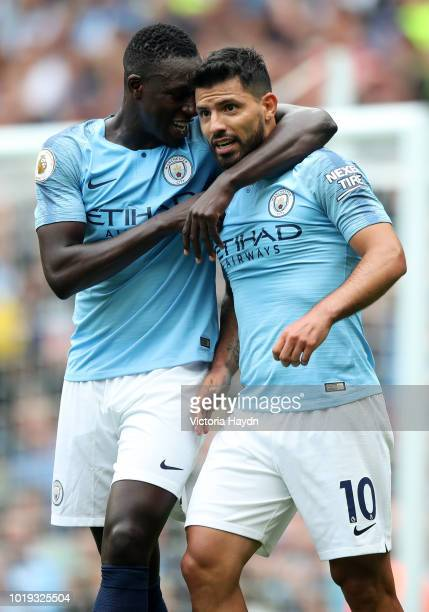 Sergio Aguero of Manchester City celebrates with teamate Benjamin Mendy after scoring his team's first goal during the Premier League match between...