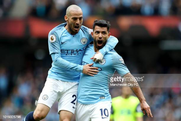Sergio Aguero of Manchester City celebrates with teamate David Silva after scoring his team's first goal during the Premier League match between...