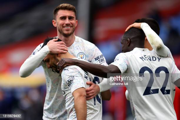 Sergio Aguero of Manchester City celebrates with teammate Aymeric Laporte after scoring his team's first goal during the Premier League match between...