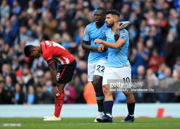Sergio Aguero of Manchester City celebrates with teammate Benjamin Mendy of Manchester City after assisting Raheem Sterling of Manchester City who...