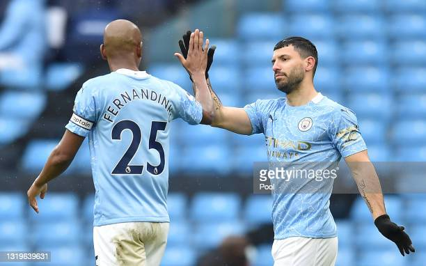 Sergio Aguero of Manchester City celebrates with teammate Fernandinho after scoring his team's fifth goal during the Premier League match between...
