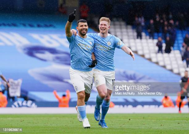 Sergio Aguero of Manchester City celebrates with teammate Kevin De Bruyne after scoring his team's fourth goal during the Premier League match...