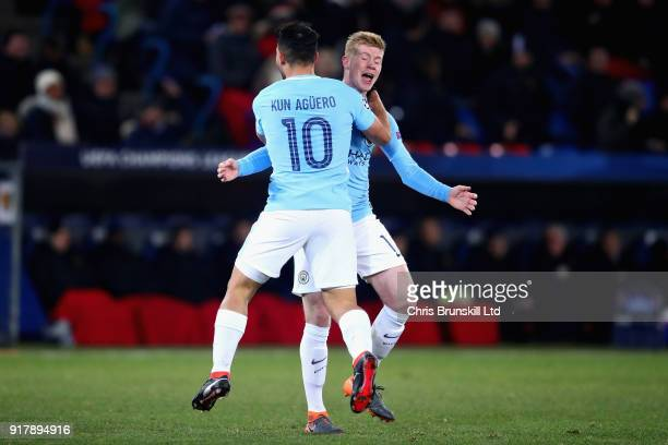 Sergio Aguero of Manchester City celebrates with teammate Kevin De Bruyne after scoring his teams third goal during the UEFA Champions League Round...