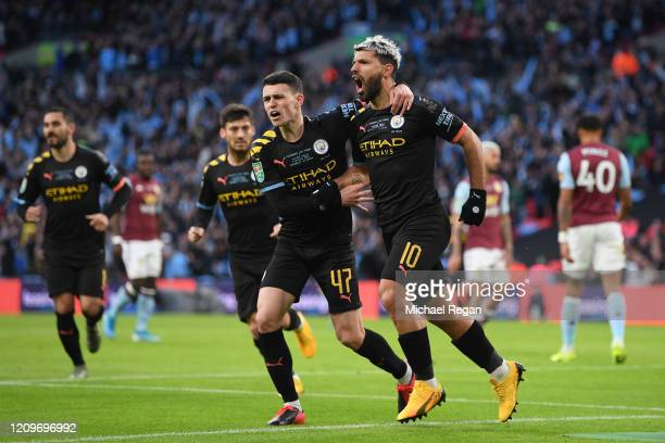 Sergio Aguero of Manchester City celebrates with teammate Phil Foden after scoring his team's first goal during the Carabao Cup Final between Aston...