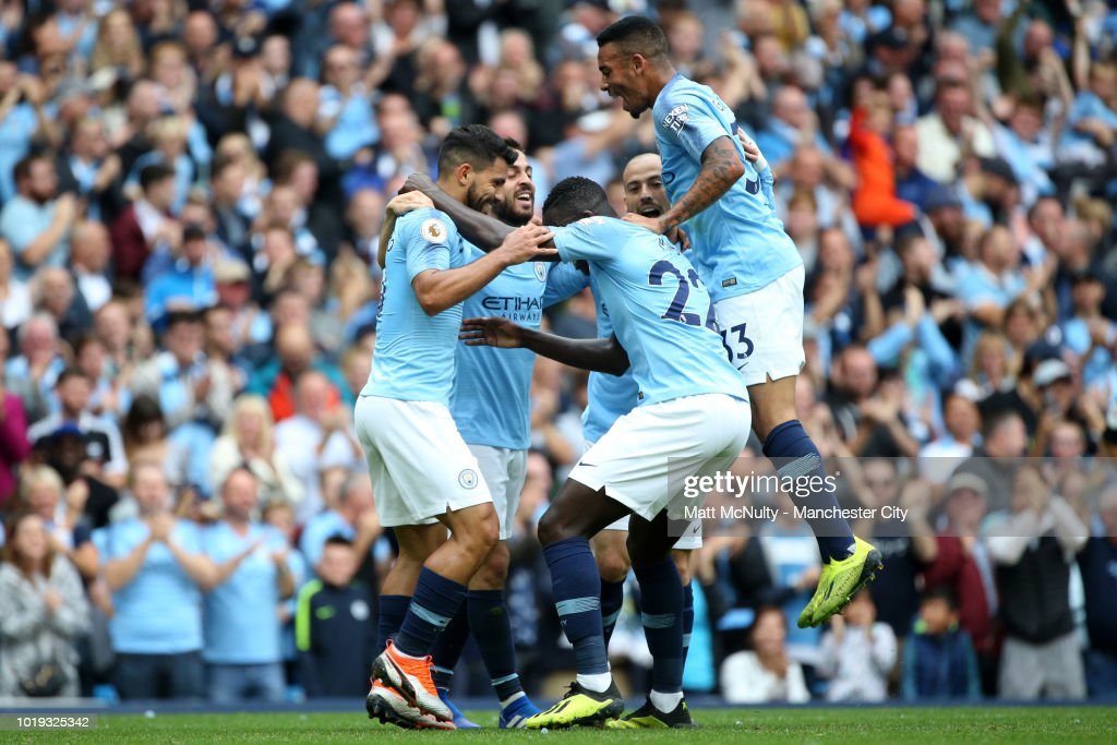 Sergio Aguero of Manchester City celebrates with teammates after scoring his team's first goal during the Premier League match between Manchester City and Huddersfield Town at Etihad Stadium on August 19, 2018 in Manchester, United Kingdom.