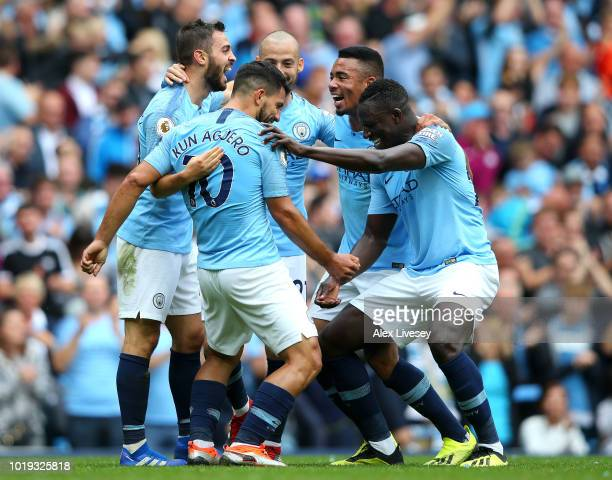 Sergio Aguero of Manchester City celebrates with teammates after scoring his team's first goal during the Premier League match between Manchester...
