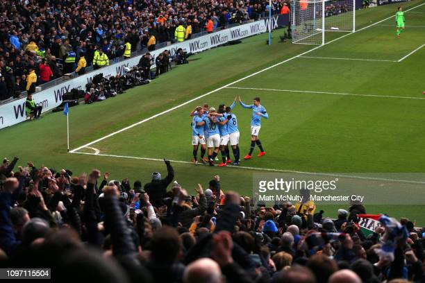 Sergio Aguero of Manchester City celebrates with teammates after scoring his team's second goal during the Premier League match between Manchester...