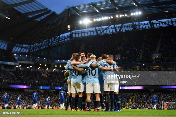 Sergio Aguero of Manchester City celebrates with teammates after scoring his team's fifth goal during the Premier League match between Manchester...