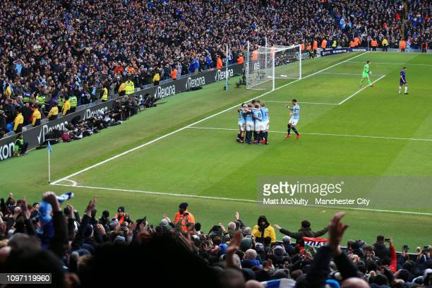 Sergio Aguero of Manchester City celebrates with teammates after scoring his team's third goal during the Premier League match between Manchester...