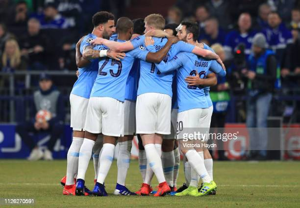 Sergio Aguero of Manchester City celebrates with teammates after scoring his team's first goal during the UEFA Champions League Round of 16 First Leg...