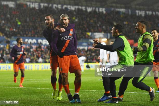 Sergio Aguero of Manchester City celebrates with teammates after scoring his team's third goal during the FA Cup Quarter Final match between Swansea...
